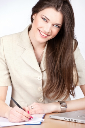 Young pretty female manager taking notes Stock Photo - 14881059