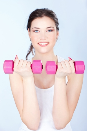 Young woman doing fitness exercises Stock Photo - 14880815