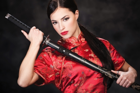catfight: Pretty woman holding katana weapon