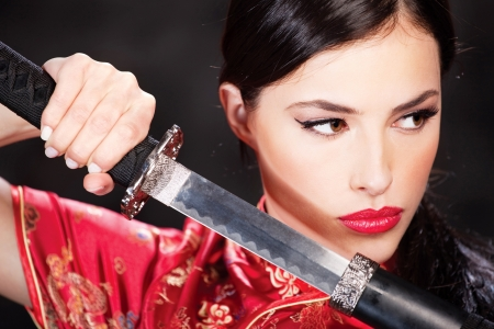 Close up of a pretty woman and katana