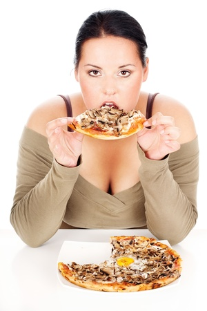 chubby woman enjoy eating a slice of pizza, isolated on white