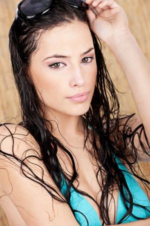 wet bikini: Wet bikini woman with sun glasses in tropical environment Stock Photo