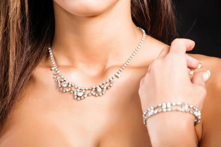 necklace on womans neck on dark backround