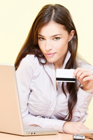 service card: Pretty woman can online shopping with credit card Stock Photo