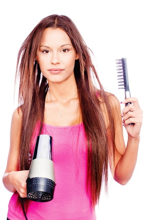 hair dresser: woman with long hair holding blow dryer and comb, isolated on white