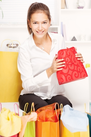young woman on sofa with shopping bags at home Stock Photo - 15647671