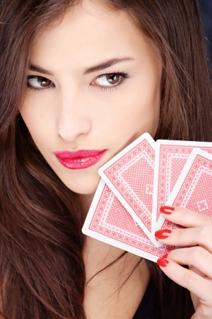 Pretty long hair woman holding gambling cards
