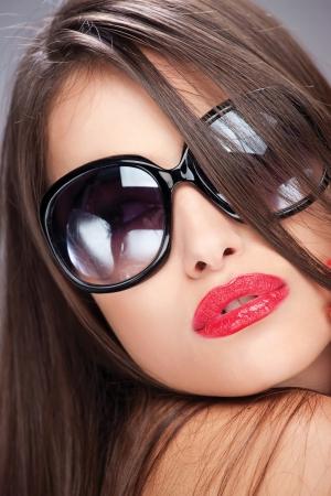 provocative: Pretty woman with big sun glasses