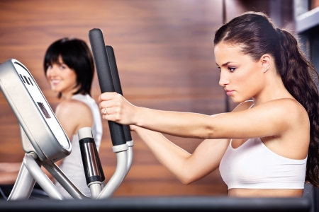Women doing exercise in gym center photo