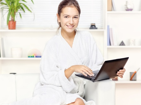 Woman in bathrobe at home with computer Stock Photo - 16761939