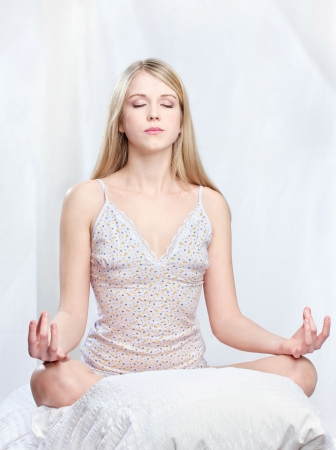 yoga pillows: Young woman meditate at home