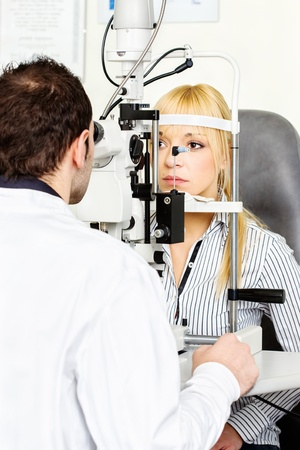 diopter: Eye doctor performing an eye examination