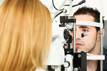 medical attendance: Male patient is having a medical attendance at the optometrist