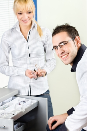 Man trying on eyeglasses at optometrists shop Stock Photo - 17499537