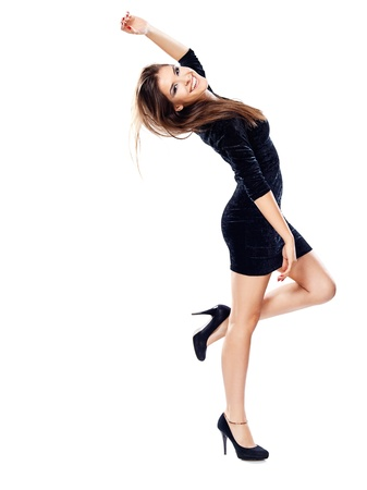 happy woman in black dress on heels with one hand up, isolated