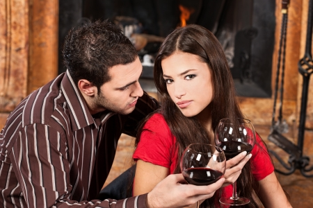 Young couple in love near fireplace photo