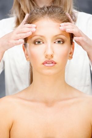 head massage: Pretty woman on head massage treatment Stock Photo