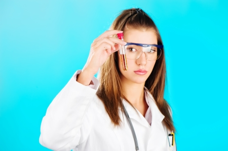 biologist: Woman looking at the chemical tube, focus on tube Stock Photo