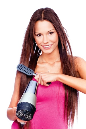 blow dryer: woman with long hair holding blow dryer and comb