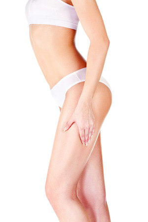 pinch: Woman pinching leg for skin fold test, isolated on white. Health concept  Stock Photo