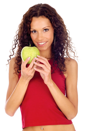 greeen: Curl hair brunette woman holding greeen apple, isolated