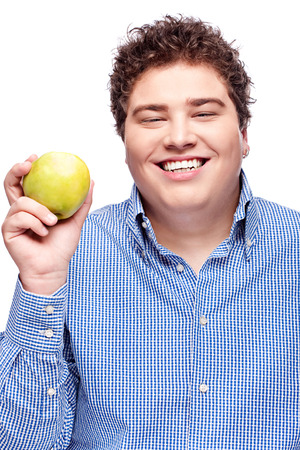 Happy chubby man holding apple, isolated on white