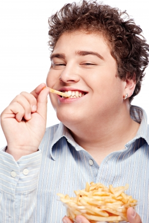 Happy young chubby man with french fries in dish, isolate on white