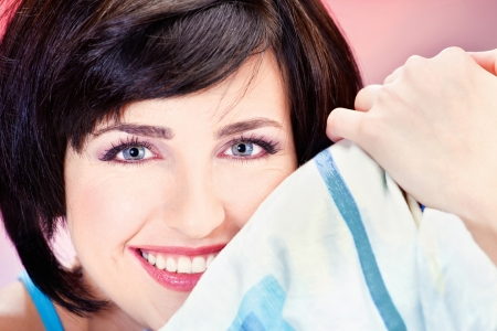 Cute smiling short hair girl on pillow Stock Photo