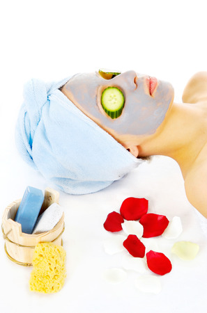 Young woman with blue mask lying on the cosmetic table Stock Photo - 23727472