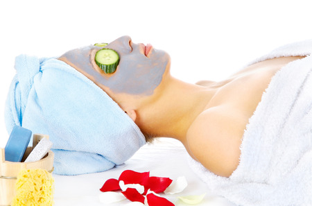 Young woman with blue mask lying on the cosmetic table Stock Photo