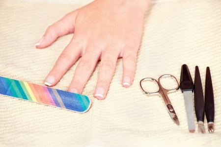 Nails beauty treatment with nail file