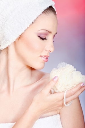 Pretty woman taking skin care with sponge