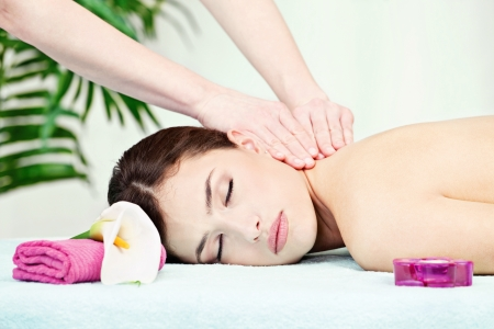 Woman on neck massage in salon photo