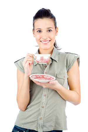 Young smiled brunette girl holding a teapot, isolated on white background Stock Photo