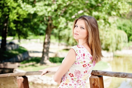 Cute brunette woman on sunny day in park, outdoor Stock Photo