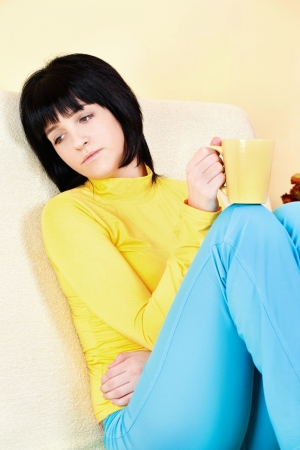 contemplate woman at home on sofa