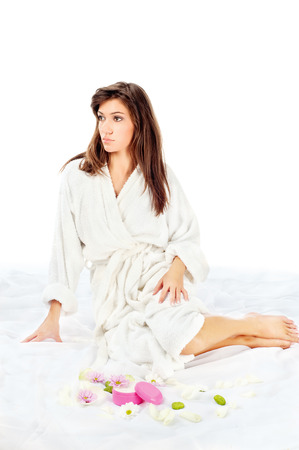 Relaxed spa woman in bathrobe isolated on white background