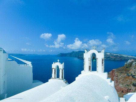 church bell: View to the sea from church bell tower in Oia the most beautiful village of Santorini island in Greece