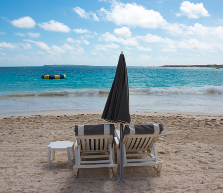two chairs: Two chairs and umbrella on Caribbean tropical beach