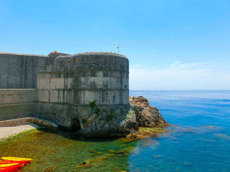 croatia dubrovnik: Dubrovnik, Croatia - June 07, 2015: View on the fortress and marina in the old town of Dubrovnik, Croatia. Dubrovnik is a UNESCO World Heritage site