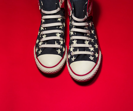 converse: Dnipropetrovsk, Ukraine - May, 29 2016: All Star Converse sneakers on red background