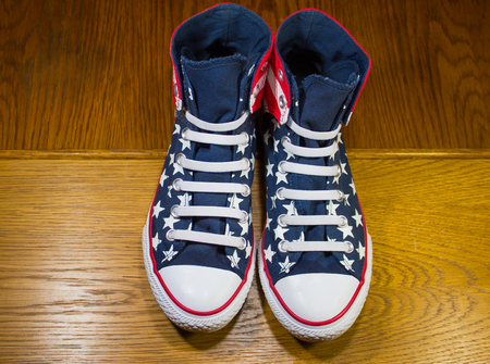converse: Dnipropetrovsk, Ukraine - June, 13 2016: All Star Converse sneakers on wooden background
