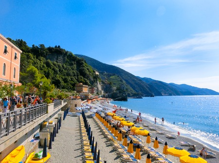 monterosso: MONTEROSSO, ITALY - SEPTEMBER 09, 2015: People on the coastline of Monterosso in Italy. Monterosso is one of five famous coastline villages in the Cinque Terre National Park. Editorial