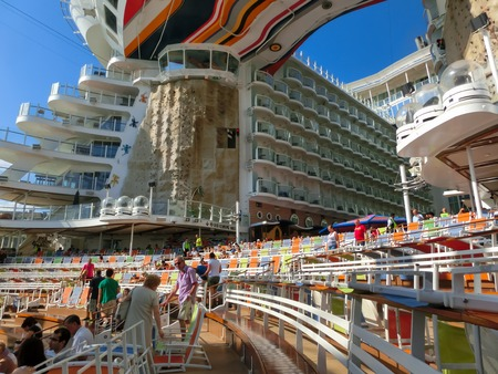 allure: Barselona, Spaine - September, 6 2015: Royal Caribbean, Allure of the Seas sailing from Barselona on September 6 2015. The second largest passenger ship constructed behind sister ship Oasis of the Seas. The viewers preparing for the show