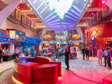 allure: Barselona, Spaine - September, 6 2015: Royal Caribbean, Allure of the Seas sailing from Barselona on September 6 2015. The second largest passenger ship constructed behind sister ship Oasis of the Seas. Passengers walking inside the ship