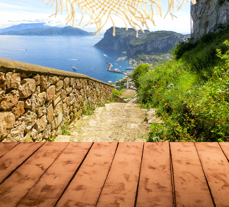 floo: The collage of wooden floor and view of Capri island, Italy. Concept  welcome to paradise Stock Photo