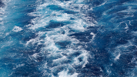 gran canaria: The foam on the blue water of sea