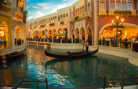 flutter: Las Vegas, United States of America - May 06, 2016: The Venetian Resort Hotel and Casino in Las Vegas. The resort opened on May 3, 1999 with flutter of white doves, sounding trumpets, singing gondoliers actress Sophia Loren Editorial