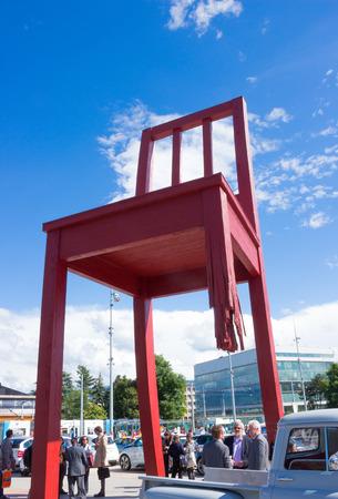 broken chair: GENEVA, SWITZERLAND - JUNE 17, 2016: The gigantic Broken Chair, symbol of the fight against landmines