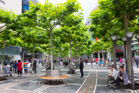 paveway: Frankfurt, Germany - June 15, 2016: people walk along the Zeil in Midday in Frankfurt, Germany. Since the 19th century it is of the most famous and busiest shopping streets in Germany.